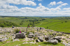 People enjoying the view from the top of Malham Cove Yorkhire Dales. YORKSHIRE DALES, ENGLAND, UK-JUNE 7TH 2017: Beautiful sunshine and fine weather was enjoyed Stock Photos