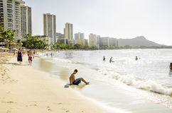 People Enjoying Waikiki Beach in December Stock Images