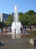People enjoying water fall. On a very hot day children are enjoying water fall royalty free stock photo