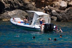 People enjoying water at Mallorca beach in Spain. Mallorca, Spain - June 28, 2017: People enjoy the water on a warm summer`s day at Cala Deia Beach Stock Photos