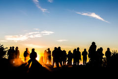 People enjoys the sunrise on the top of Merbabu volcano in Java  in Indonesia Royalty Free Stock Photo
