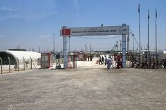 People enter the Akcakale Syrian  refugee camp Stock Photo
