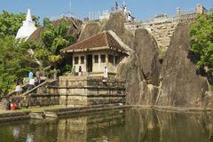 People enter Isurumuniya rock temple in Anuradhapura, Sri Lanka. Royalty Free Stock Photography