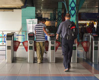 People enter to the flatform at subway station in Kuala Lumpur, Malaysia Stock Photos