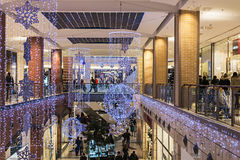 People enter to Metropolis shop before Christmas Royalty Free Stock Photography