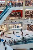 People enter to Metropolis shopping center in Moscow, Russia. RUSSIA, MOSCOW - MARCH 23, 2014: People enter to Metropolis shopping center in Moscow, Russia royalty free stock image