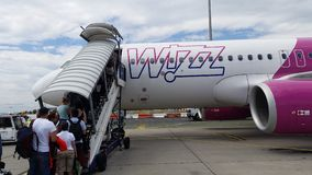 People enter Wizzair airplane Royalty Free Stock Image