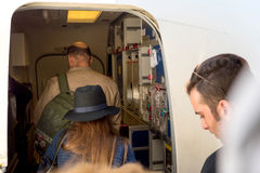 People entering airplane through door airport Stock Photography