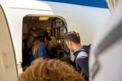 People entering airplane through door airport Royalty Free Stock Photo