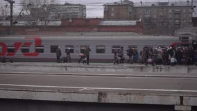 People entering car of suburban train at Moscow railway station.12.12.2015. Clip stock video
