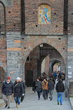 People are entering and leaving Sforza castle in Stock Photography