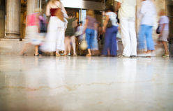 People entering into modern shop. Blurred motion royalty free stock photography