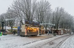 People entering the snow covered Winterland on the Parade in the center of Den Bosch. Royalty Free Stock Image