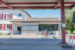 People entering Switzerland from France in Mon Idee, an abandoned border crossing from the Swiss Customs. MON IDEE, SWITZERLAND - JUNE 18, 2017: People entering stock photo