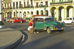 People entering a taxi in Old Havana, Cuba Royalty Free Stock Photo