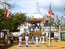 People entering temple to pray. People attending a Buddhist temple  in Sri Lanka to pray Royalty Free Stock Images