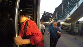 People entering the train at the train station in Mumbai. MUMBAI, INDIA - 7 JANUARY 2015: People entering the train at the train station in Mumbai stock footage