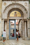 People at the entrance door of the Euphrasian Basilica on Porec Royalty Free Stock Photography