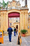 People at Entrance gate into Natural History Museum Mdina Malta. Mdina, Malta - April 4, 2014: People at Entrance gate into Natural History Museum in Mdina Royalty Free Stock Photo