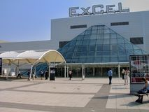 People at entrance to international exhibitions and convention centre ExCeL. LONDON, UK - SEPT 6, 2004: People at entrance to international exhibitions and Royalty Free Stock Photos