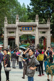 People at the entrance to the Wong Tai Sin Temple in Hong Kong Royalty Free Stock Image