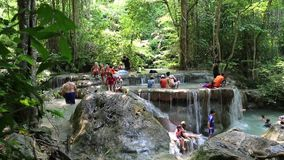 People in Erawan National Park and Erawan Waterfall in western Thailand Royalty Free Stock Photo