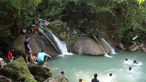People in Erawan National Park and Erawan Waterfall in western Thailand Stock Photo