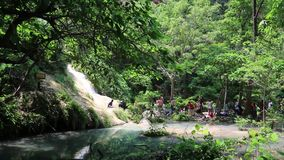 People in Erawan National Park and Erawan Waterfall in western Thailand stock video footage