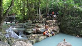 People in Erawan National Park and Erawan Waterfall in western Thailand stock video