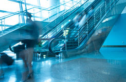 People and escalator,airport. People rush on escalator motion blurred,in airport Royalty Free Stock Photo
