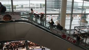 People on the escalator at the airport stock video footage