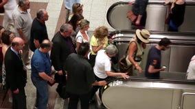 People on escalator stock video