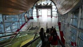 People on escalator inside Dubai metro station, United Arab Emirates. UAE, DUBAI, FEBRUARY 1, 2016: People on escalator inside Dubai metro station, United Arab stock video