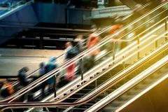 People on escalator inside  train station , travel concept blur royalty free stock photos