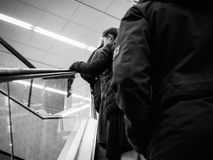 People on escalator in modern mall black and white. STRASBOURG, FRANCE - APR 27, 2017: People ascending on escalator in supermarket mall subway Royalty Free Stock Photography