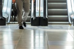 People on escalator motion blurred Stock Images