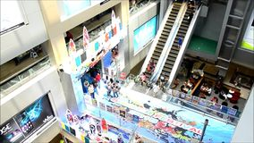 People on escalator is a moving staircase at shopping mall stock footage