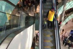 People on escalator of a nice shopping mall stock video footage