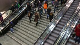 People at escalator and stair fast moving up and down stock video footage