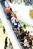 People on the escalator in the supermarket Stock Photos