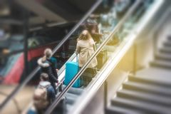 People on escalator in train station, travel concept motion blur royalty free stock photos