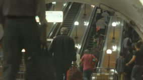People on the escalator in the underground. Hurrying people. People in the underground stock video footage