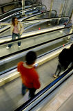 People on escalators. Overhead view of people travelling up and dawn escalators Royalty Free Stock Photos