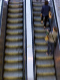 People on escalators Royalty Free Stock Photos