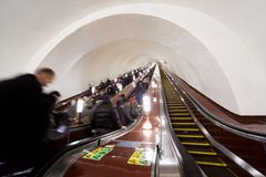 People on escalators of metro station Stock Photo