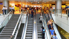 People on escalators in a shopping mall Stock Photo