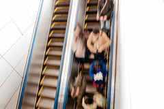 People on escalators in subway station Royalty Free Stock Images