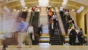 People on escalators stock video