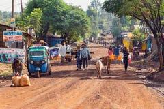 People on the Ethiopian street. DEMEBECHA, ETHIOPIA, APRIL 20.2019, People walking on the Ethiopian street in the morning. Demebecha, Ethiopia, April 20. 2019 royalty free stock image