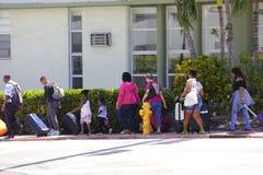 People evacuating Miami Beach Hurricane Irma. MIAMI BEACH, FL, USA - SEPTEMBER 8, 2017: Image of groups of people evacuating Miami Beach Hurricane Irma Stock Photos